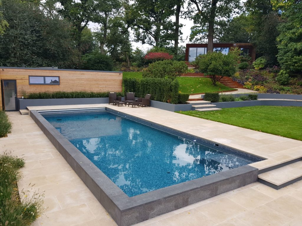 Raised walls to this London outdoor pool with black fittings and automatic cover