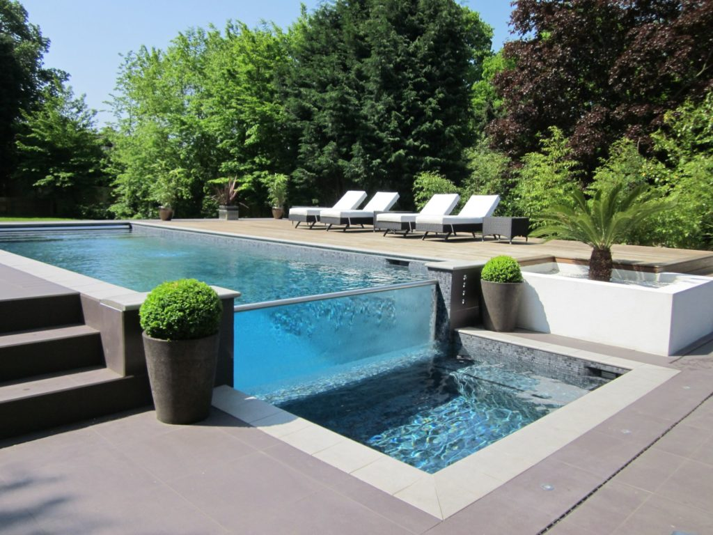 Stunning glass wall pool with champagne bubble wall and spa in this award winning, architect designed new build property