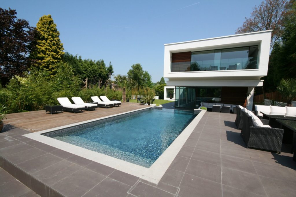 Full width steps and contemporary styling for our pool at this award winning Surrey famiily home