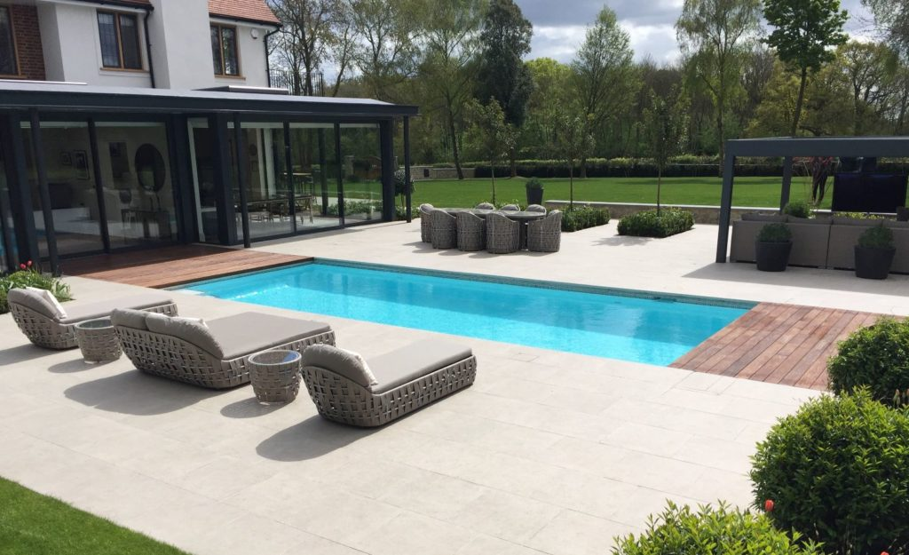 Contemporary outdoor pool with automatic cover in this country garden