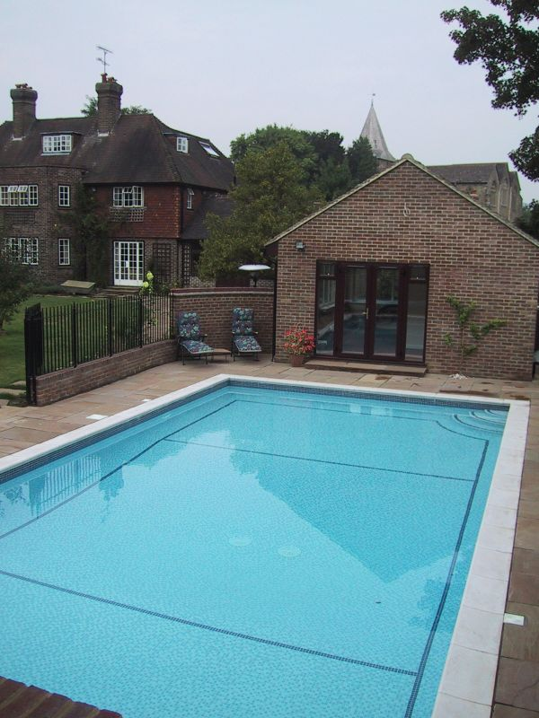Double shallow end with central deep centre area to this outdoor walled pool